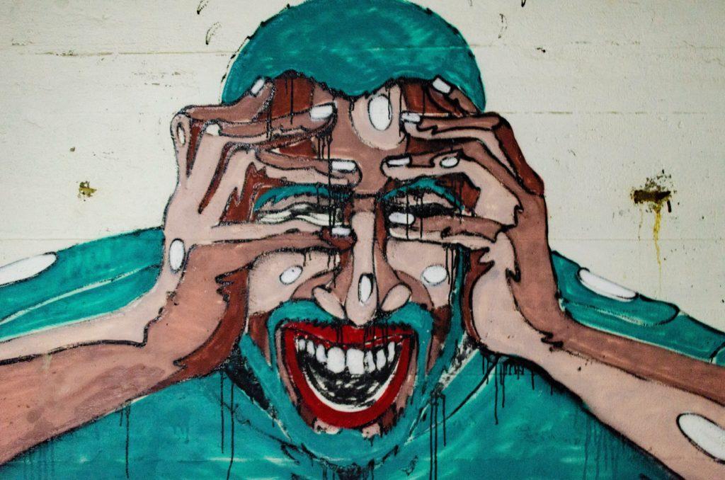 Wandgemälde mit schreiendem Mann